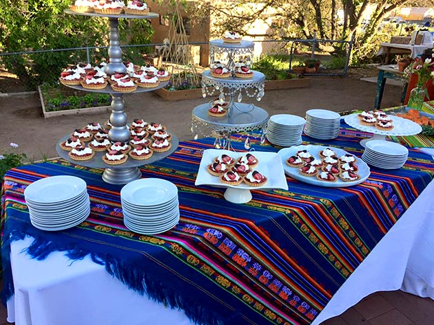 Dessert station featuring delicious strawberry tarts with St. Germaine whipped cream by Casa Nova Custom Catering, Santa Fe, NM