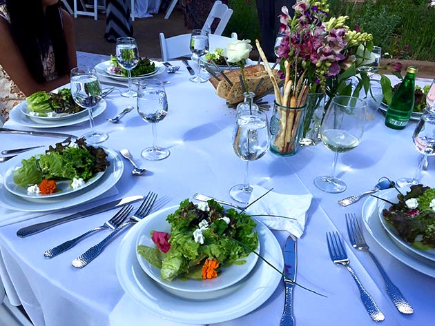Elegant table set with wedding bouquet salad for a wedding catered by Casa Nova Custom Catering, Santa Fe, NM