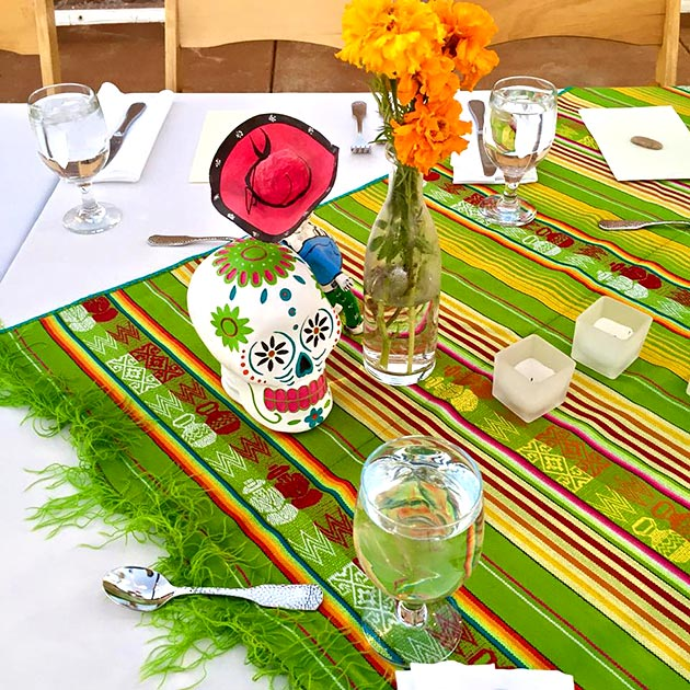 Day of the Dead table decor for Dia de los Muertos celebration catered by Casa Nova Custom Catering, Santa Fe, New Mexico