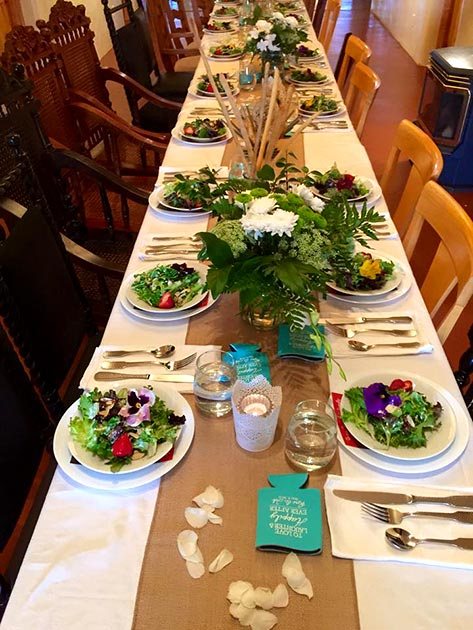 A festive table set with salad first course by Casa Nova Custom Catering, Santa Fe, NM