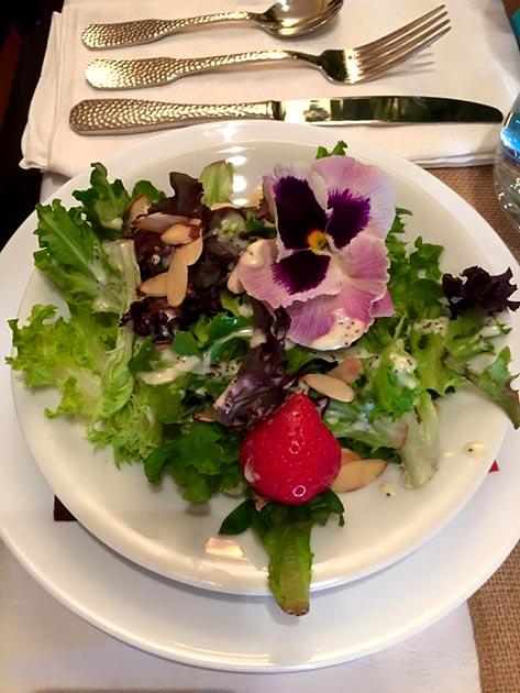 Colorful edible flower, fruit and greens salad by Casa Nova Custom Catering, Santa Fe, NM