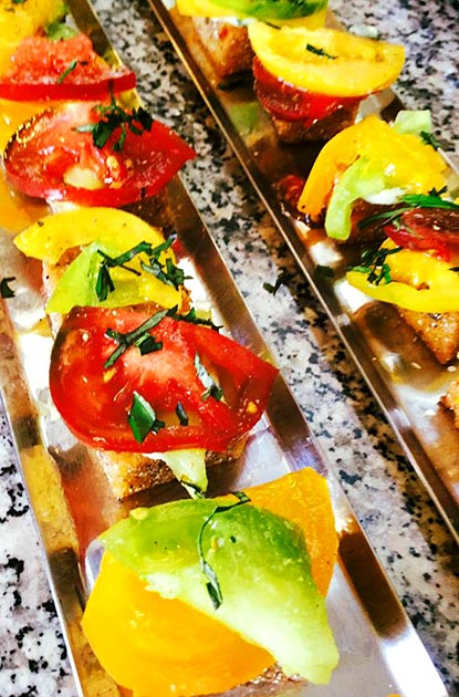 Heirloom tomato polenta bite by Casa Nova Custom Catering, Santa Fe, New Mexico
