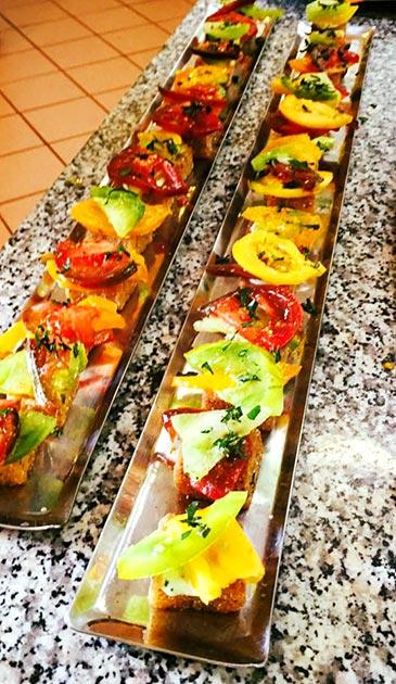 Heritage tomato polenta bite appetizers by Casa Nova Custom Catering, Santa Fe, NM