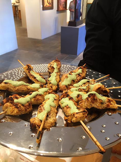 A platter of chicken skewers with avocado crema by Casa Nova Custom Catering, Santa Fe, NM
