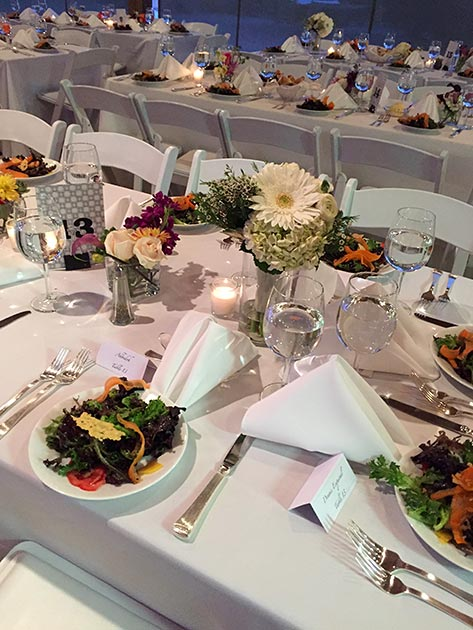 Set table with local greens wedding salad, catering by Casa Nova Custom Catering, Santa Fe, NM