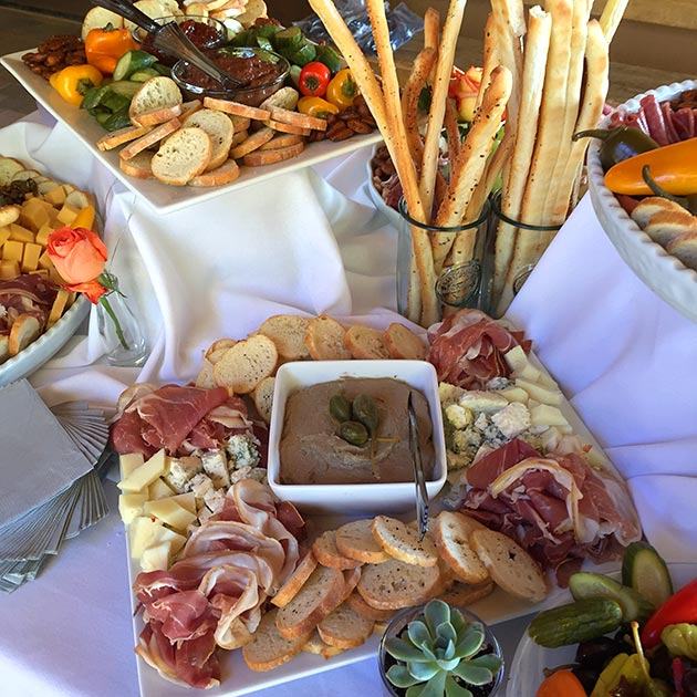 An abundant antipasto table with appetizers by Casa Nova Custom Catering, Santa Fe, NM