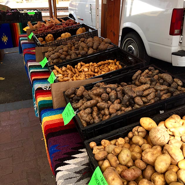 Buying local at the Santa Fe Farmers Market for a catered event by Casa Nova Custom Catering, Santa Fe, NM