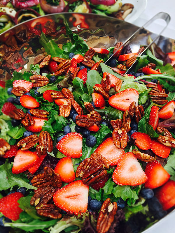 Strawberry Blueberry Glazed Pecan Salad from a catered wedding by Casa Nova Custom Catering, Santa Fe, New Mexico