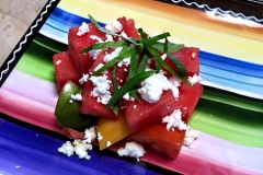 Local, heirloom tomato salad with basil by Casa Nova Custom Catering, Santa Fe, NM