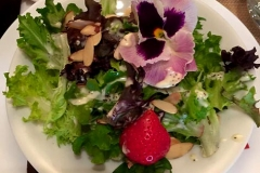 Colorful edible flower, fruit and greens salad by Casa Nova Custom Catering, Santa Fe, NM