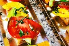Heirloom tomato polenta bite by Casa Nova Custom Catering, Santa Fe, New Mexico