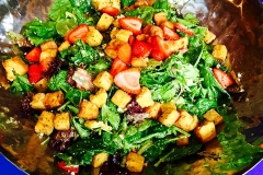 Fresh greens and fruit salad with polenta croutons by Casa Nova Custom Catering, Santa Fe, NM