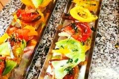 Heirloom tomato polenta bite appetizers by Casa Nova Custom Catering, Santa Fe, NM