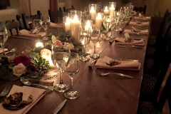 The candlelit table for Hacienda Doña Andrea catered wedding by Casa Nova Custom Catering, Santa Fe, New Mexico